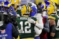 Green Bay Packers quarterback Aaron Rodgers (12) is congratulated by Los Angeles Rams quarterback Jared Goff after an NFL divisional playoff football game Saturday, Jan. 16, 2021, in Green Bay, Wis. The Packers defeated the Rams 32-18 to advance to the NFC championship game. (AP Photo/Matt Ludtke)