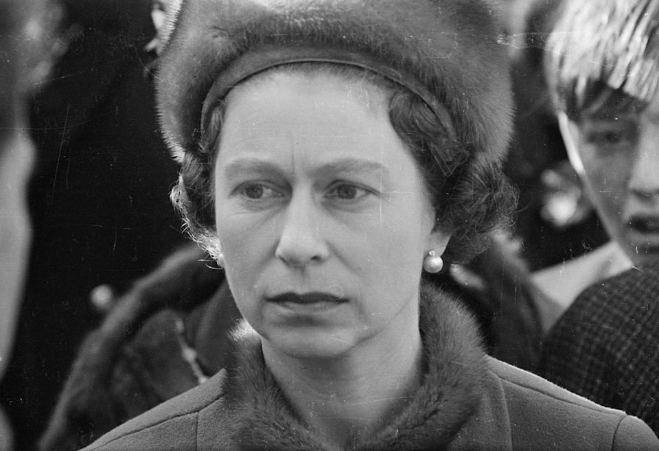 <p>Queen Elizabeth visits Aberfan, Wales in 1966 after 144 people died when a coal tip collapsed on the local school.</p>