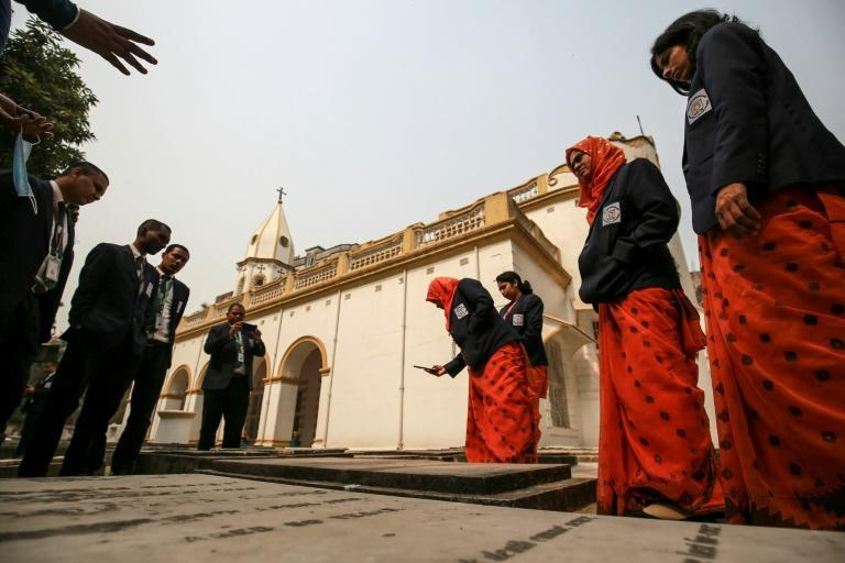 Several assistants help Ghosh maintain the church and feed the half a dozen stray dogs living in the grounds