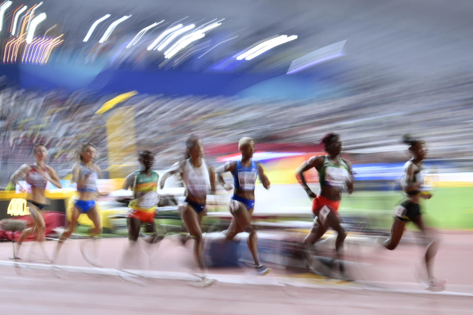 Natoya Goule, of Jamaica, Noélie Yarigo, of Benin, and Ce'Aira Brown, of the United States, from right, compete during the women's 800 meters heats during the World Athletics Championships Friday, Sept. 27, 2019, in Doha, Qatar. (AP Photo/Martin Meissner)