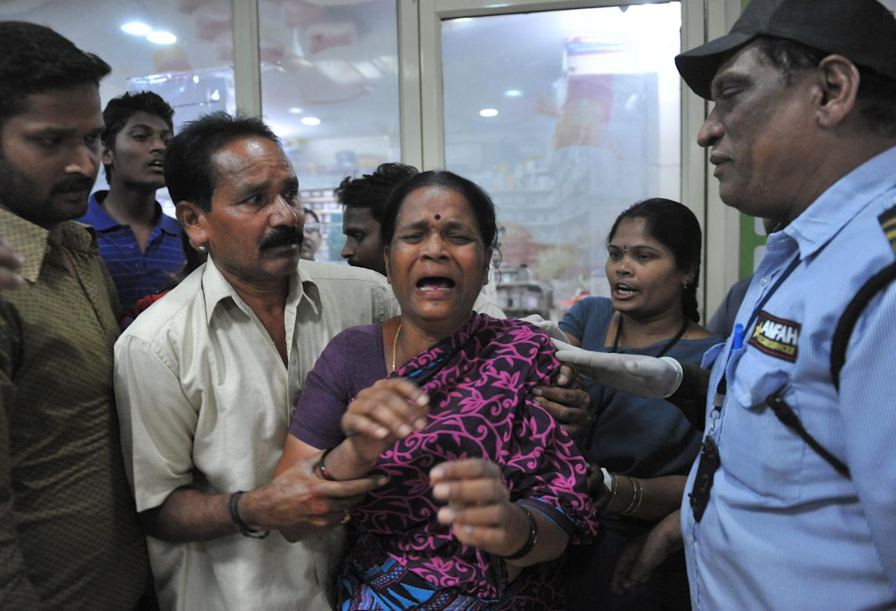 A relative reacts at the Omini hospital Kothapet following bomb blasts in Hyderabad on February 21, 2013. At least 12 people were killed and 52 injured when three bombs shook the southern Indian city of Hyderabad late on Thursday, police said. AFP PHOTO / Noah SEELAM        (Photo credit should read NOAH SEELAM/AFP/Getty Images)