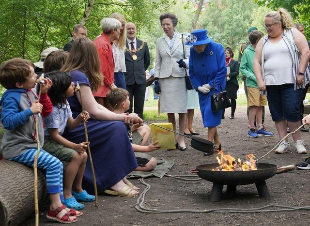 The Queen views marshmallows being toasted