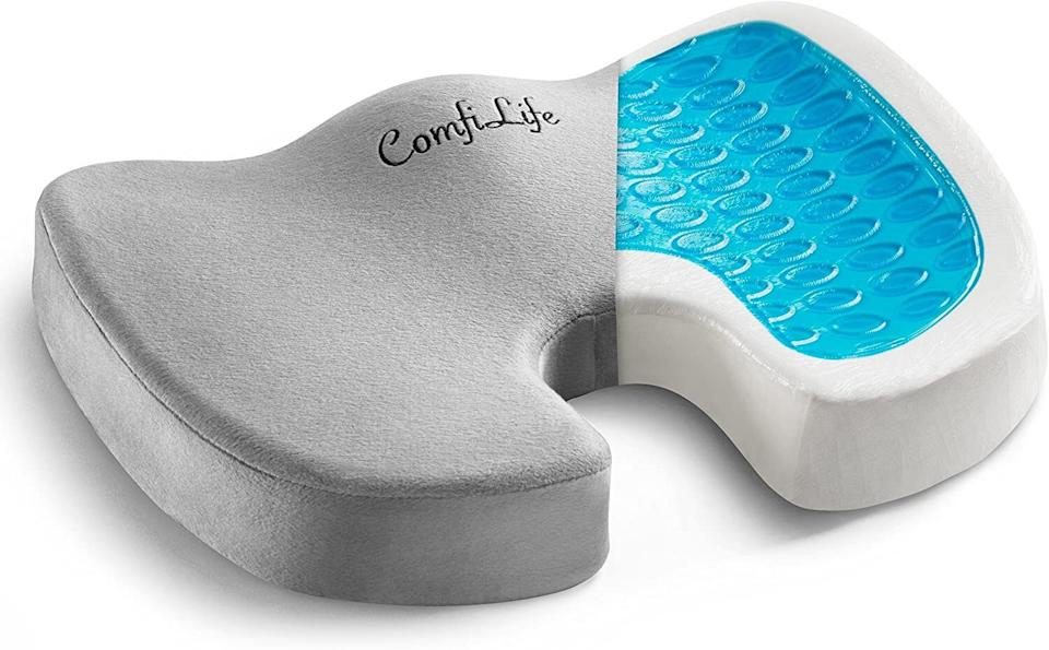 """This is so effective at relieving pressure from your tailbone that you'll no longer have a love-hate relationship with your office chair.<br /><br /><strong>Promising review:</strong>""""I have an active sciatic nerve and it's pinched because of my job where I need to sit for hours together.<strong>I had tried everything from standing up, using three different cushions, including that purple or egg seater thingie.</strong>Nothing worked. Particularly that egg seater is a hogwash — just a waste of money. Every night, I had to apply ice packs, medicinal patches. Then I saw ComfiLife, read the reviews, and finally decided to buy one. I have been using this for a few months now. Here is my experience: 1.<strong>The gel takes the ideal shape in such a way it doesn't put pressure on the nerve</strong>. I don't know if it is scientific but personally I DON'T feel like I'm sitting on a rock! 2. At the same time, it's not saggy or goes flat like that egg thingie, when you sit on this. 3. I don't know if anyone else felt it, I get this cool icy feel on the same sciatic nerve when I sit on this cushion, say, for an hour!! 4.<strong>I have sat on it for four hours without a break and I don't have the same pain I used to have!</strong>5. The color of the cushion cover is ideal and doesn't look dirty at all. And it's removable!! Summary:<strong>Yes, you can sit for eight hours on this cushion and not writhe in pain later. Yes, this is worth the money to spend.</strong>And within a week, you will figure out if it works for you. Finally, I'm gonna get two more for my office and my car."""" —<a href=""""https://www.amazon.com/gp/customer-reviews/RYQL1Q1FU46RH?ascsubtag=5738624%2C11%2C35%2Cd%2C0%2C0%2C0%2C962%3A1%3B901%3A2%3B900%3A2%3B974%3A2%3B975%3A2%3B982%3A2%3B994%3A1%2C0%2C0&linkCode=ll2&tag=huffpost-bfsyndication-20&linkId=5610279b79eceb9f942e86d4a3f686e9&language=en_US&ref_=as_li_ss_tl"""" target=""""_blank"""" rel=""""nofollow noopener noreferrer"""" data-skimlinks-tracking=""""5738624"""" data-vars-affil"""