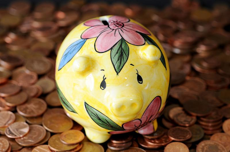 A piggy bank on a pile of coins. (Photo by Nick Ansell/PA Images via Getty Images)