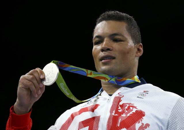 2016 Rio Olympics - Boxing - Victory Ceremony - Men's Super Heavy (+91kg) Victory Ceremony - Riocentro - Pavilion 6 - Rio de Janeiro, Brazil - 21/08/2016. Silver medallist Joseph Joyce (GBR) of Britain poses with his medal. REUTERS/Peter Cziborra FOR EDITORIAL USE ONLY. NOT FOR SALE FOR MARKETING OR ADVERTISING CAMPAIGNS.