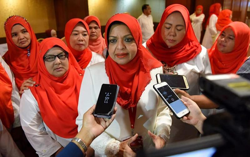 Outgoing Wanita Umno chief Tan Sri Shahrizat Abdul Jalil (centre) said she had relinquished all her positions in Umno, including at the branch, division, and national levels.