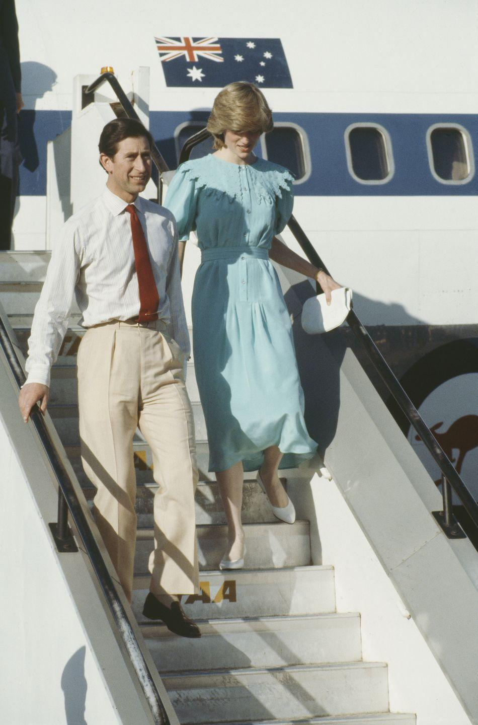 <p>Here's Charles and Di stepping off the plane and into their life on tour. A little awkward, but that might just be due to the length of Charles' pants.</p>