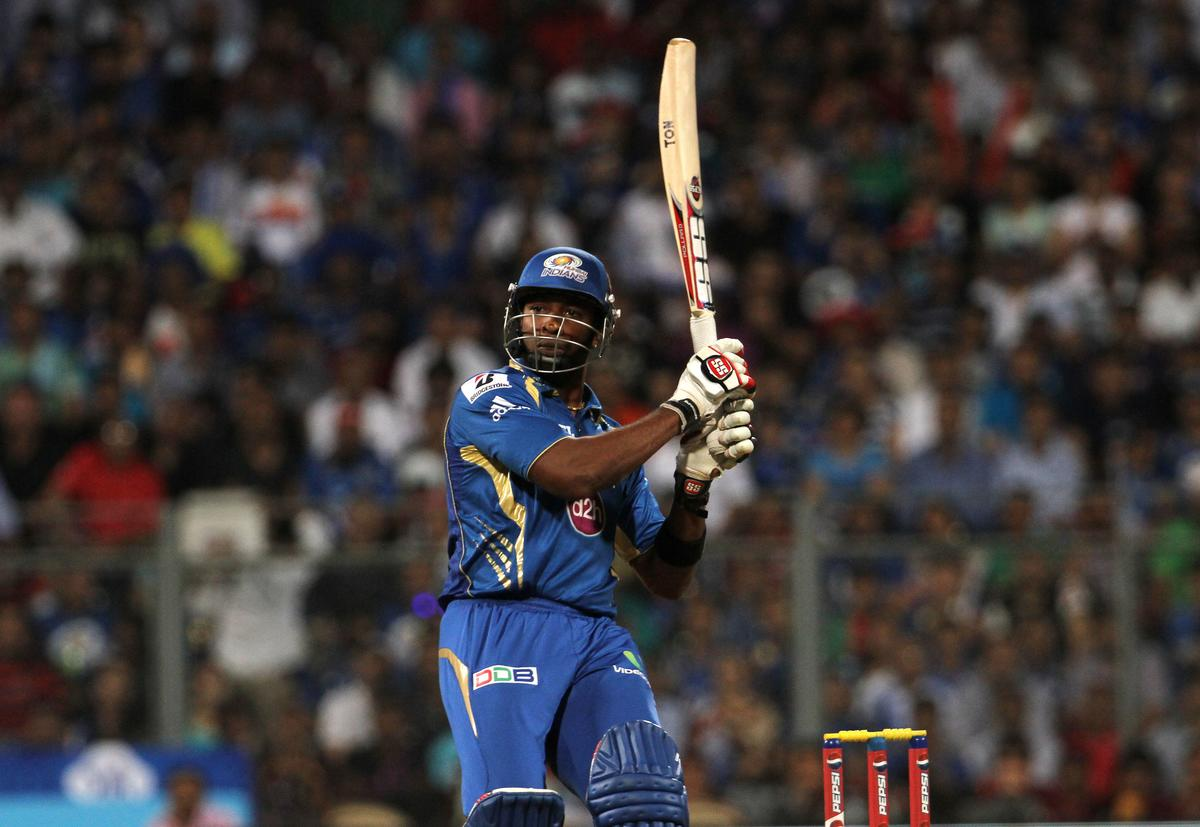 Mumbai Indian player Kieron Pollard plays a shot during match 53 of the Pepsi Indian Premier League ( IPL) 2013  between The Mumbai Indians and the Kolkata Knight Riders held at the Wankhede Stadium in Mumbai on the 7th May 2013. ..Photo by Vipin Pawar-IPL-SPORTZPICS ..Use of this image is subject to the terms and conditions as outlined by the BCCI. These terms can be found by following this link:..https://ec.yimg.com/ec?url=http%3a%2f%2fwww.sportzpics.co.za%2fimage%2fI0000SoRagM2cIEc&t=1503229413&sig=AORTDU0B.Pe4Ews0tcZnUA--~D