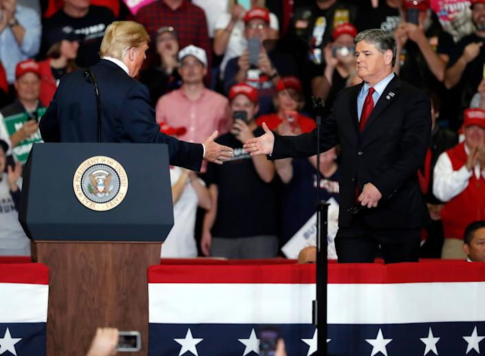 Sean Hannity lauded President Donald Trump and slammed other members of the media while on stage with the president at a campaign rally in Cape Girardeau, Missouri, in November 2018. (Photo: Jeff Roberson/ASSOCIATED PRESS)