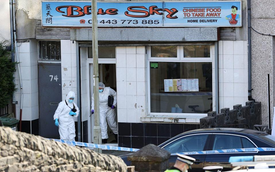 Police forensic examiners at the scene of serious incident - Chris Fairweather/Huw Evans/Shutterstock
