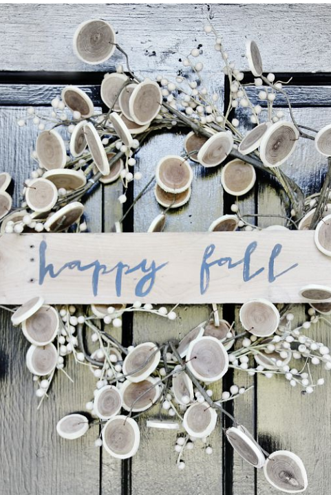 """<p>Made of wood slices and twigs, this """"Happy Fall"""" wreath is anything but kitschy. There's no better way to get such a simple message across!</p><p><strong>Get the tutorial at <a href=""""http://www.thistlewoodfarms.com/10-fall-decorating-trends/"""" rel=""""nofollow noopener"""" target=""""_blank"""" data-ylk=""""slk:Thistlewood Farms"""" class=""""link rapid-noclick-resp"""">Thistlewood Farms</a>.</strong> </p>"""