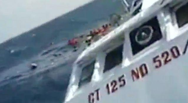 The photographer struggles to hold the camera steady as wave batter the boat. Photo: Screenshot