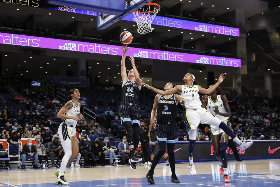 Chicago Sky guard Courtney Vandersloot (22) shoots against the Dallas Wings during the first half in the first round of the WNBA basketball playoffs, Thursday, Sept. 23, 2021, in Chicago. (AP Photo/Kamil Krzaczynski)