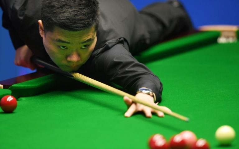 China's Ding Junhui plays a shot against China's Zhou Yuelong during their first round game of the World Snooker Championships in Sheffield, northern England, on April 18, 2017