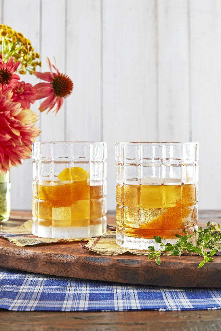 """<p>Those who aren't champagne drinkers can toast with this handcrafted cocktail.</p><p><strong><a href=""""https://www.countryliving.com/food-drinks/a24279521/orange-thyme-old-fashioned-recipe/"""" rel=""""nofollow noopener"""" target=""""_blank"""" data-ylk=""""slk:Get the recipe"""" class=""""link rapid-noclick-resp"""">Get the recipe</a>.</strong></p>"""