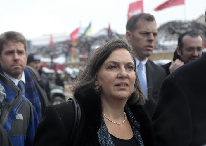 U.S. Assistant Secretary for European and Eurasian Affairs Victoria Nuland, foreground, walks through the Independence Square in Kiev, Ukraine, Tuesday, Dec. 10, 2013. Top Western diplomats headed to Kiev Tuesday to try to defuse a standoff between President Viktor Yanukovych's government and thousands of demonstrators, following a night in which police in riot gear dismantled protesters' encampments outside government buildings. (AP Photo/Sergei Chuzavkov)