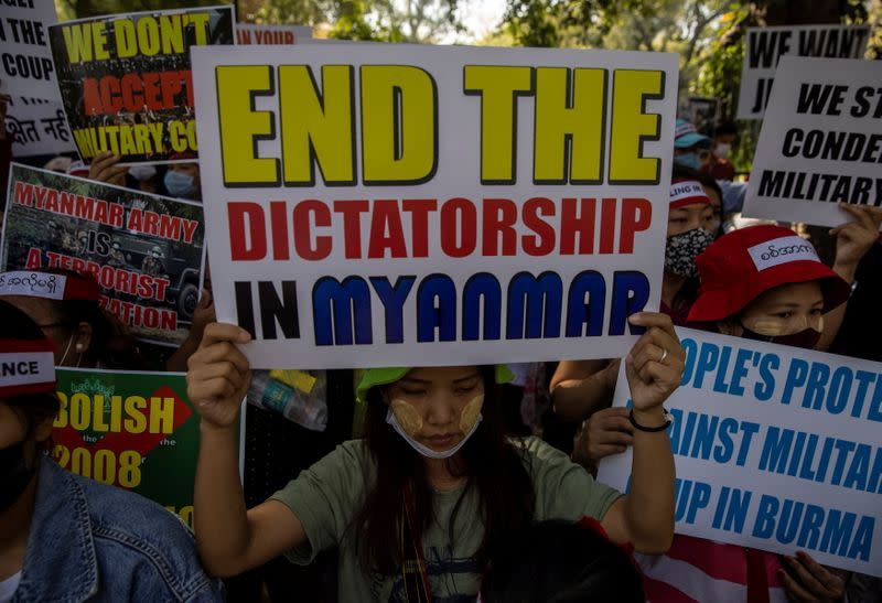 Myanmar citizens living in India hold placards during a protest against the military coup in Myanmar, in New Delhi