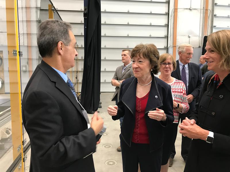U.S. Sen Susan Collins talks to Habib Dagher, executive director of the University of Maine's Advanced Structures and Composites Center, on Thursday following the school's unveiling of the world's largest 3D printer.