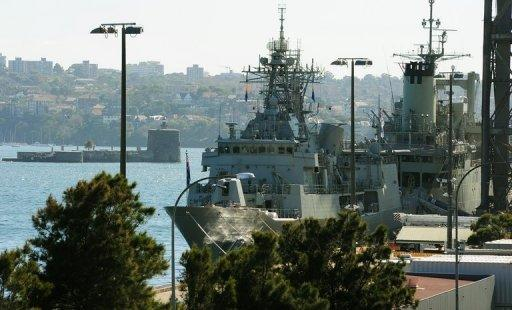 "Australian Navy ships docked at the Garden Island Naval Dockyard, near Sydney. Australian Treasurer Wayne Swan declared the ""deficit years of the global recession"" over Tuesday, unveiling a Aus$1.5 billion budget surplus funded by deep cuts to defence and foreign aid spending"