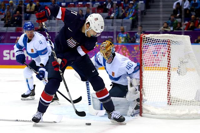 SOCHI, RUSSIA - FEBRUARY 22: James van Riemsdyk #21 of the United States handles the puck against Tuukka Rask #40 of Finland in the first period during the Men's Ice Hockey Bronze Medal Game on Day 15 of the 2014 Sochi Winter Olympics at Bolshoy Ice Dome on February 22, 2014 in Sochi, Russia. (Photo by Martin Rose/Getty Images)