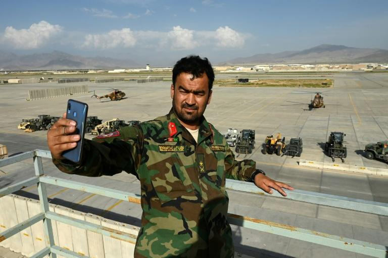 An Afghan soldier takes a selfie at Bagram on July 5, 2021, days after all US and NATO forces left the sprawling airbase