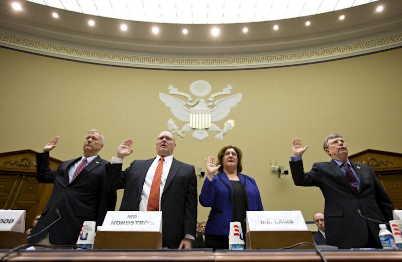 Witnesses are sworn in on Capitol Hill in Washington, Wednesday, Oct. 10, 2012, prior to testifying before House Oversight and Government Reform Committee hearing onthe attack on the American consulate in Benghazi, Libya, that resulted in the death of U.S. Ambassador Christopher Stevens and other Americans. From left are, Lt. Col. Andrew Wood, a Utah National Guard Army Green Beret who was the top security official at the consulate in Libya; Eric Nordstrom, a regional security officer with the State Department; Charlene Lamb, deputy assistant secretary for international programs at the State Department's Bureau of Diplomat Security; and Ambassador Patrick Kennedy, under secretary for management at the State Department. (AP Photo/J. Scott Applewhite)