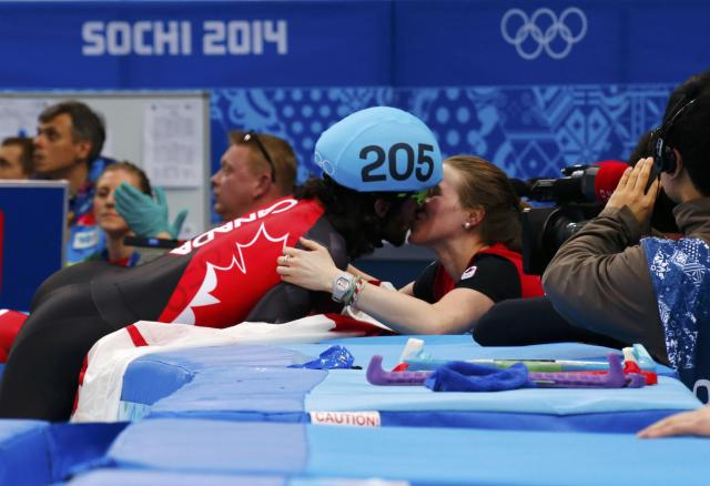 Canada's Charles Hamelin kisses his girlfriend and compatriot speed skater Marianne St-Gelais after winning the men's 1,500 metres short track speed skating race finals at the Iceberg Skating Palace during the 2014 Sochi Winter Olympics