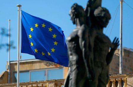 FILE PHOTO:A European flag flies outside Grandmaster's Palace on the eve of a European Union leaders summit in Valletta