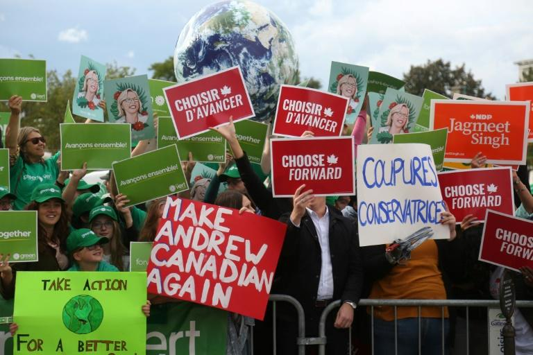 Canada's election campaign has highlighted personalities over policies (AFP Photo/Dave Chan)