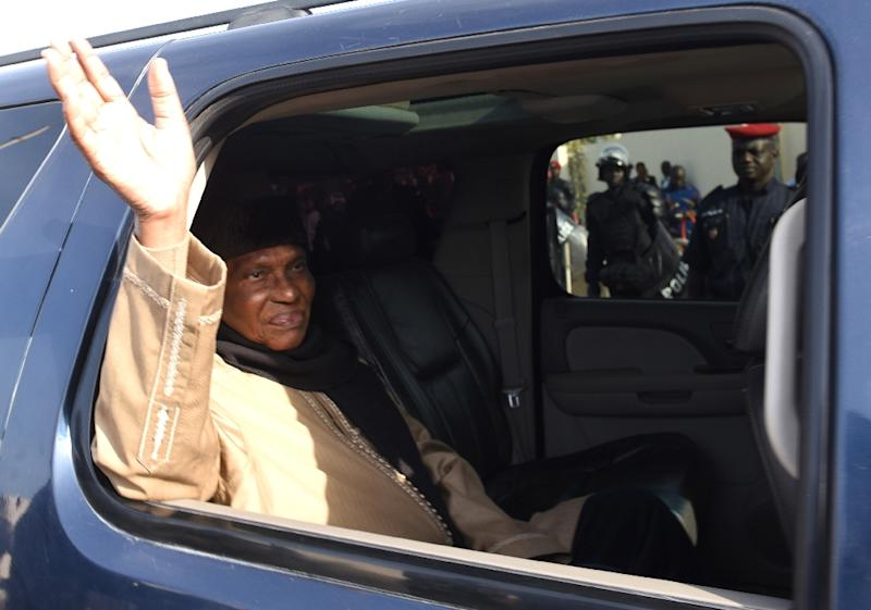 Former Senegalese president Abdoulaye Wade as he arrives at the courthouse in Dakar on March 23, 2015 (AFP Photo/Seyllou Diallo)