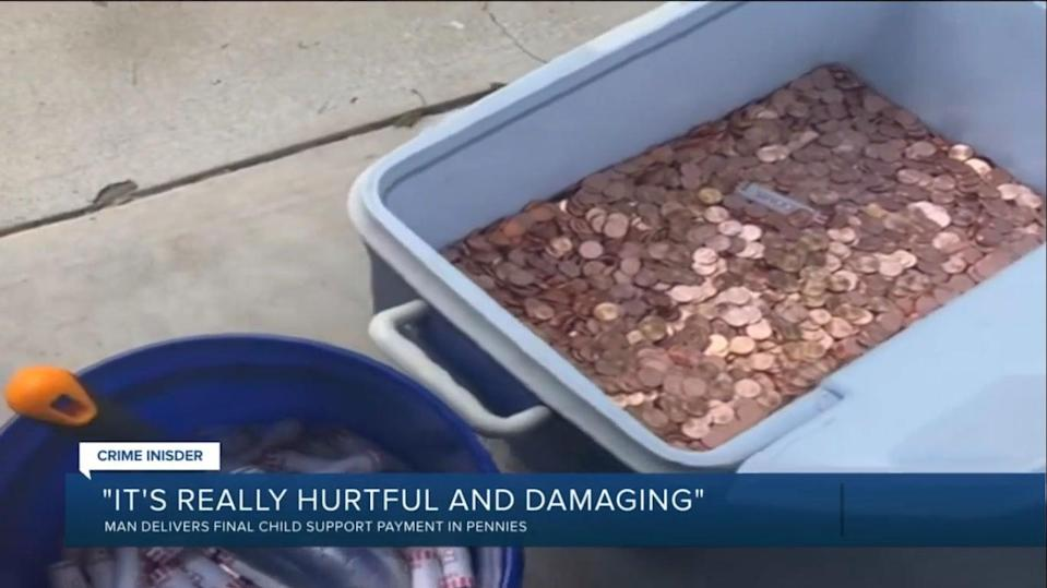 The family in Richmond neighbourhood scooped up the 80,000 pennies by using a shovel with the help of friends  (Screengrab/WTVR)