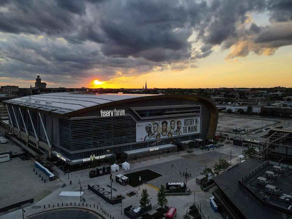The Fiserv Forum is seen as the sun sets Tuesday, June 22, 2021, in Milwaukee. Game 1 of the NBA Eastern Conference basketball finals between the Milwaukee Bucks and Atlanta Hawks is set to begin Wednesday.