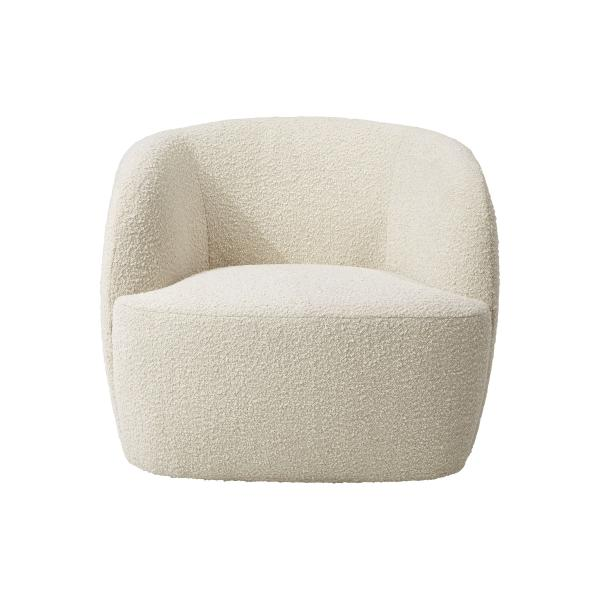 """This undated photo shows CB2's Gwyneth side chair. Designer John McClain, whose studio is in Orlando, says one big trend he's seeing in fall décor is a range of deep, cozy textures like boucle and shearling. """"(They're) are cropping up on more than just pillows these days – entire sofas, chairs and headboards are sporting luscious upholstery reminiscent of lambs, puppies and ponies."""" CB2 has several options, including the Gwyneth side chair, Logan sofa and Azalea chair. (CB2 via AP)"""