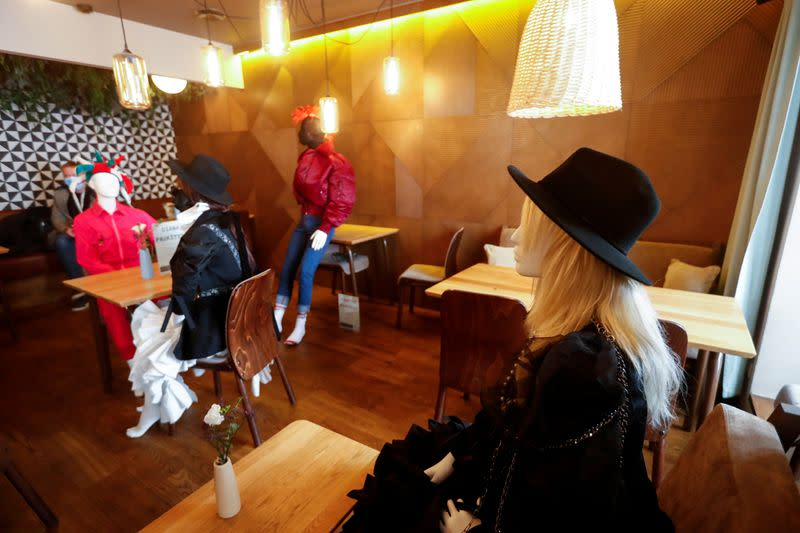 Dining dummies help cafe-goers keep a fashionable distance in Vilnius