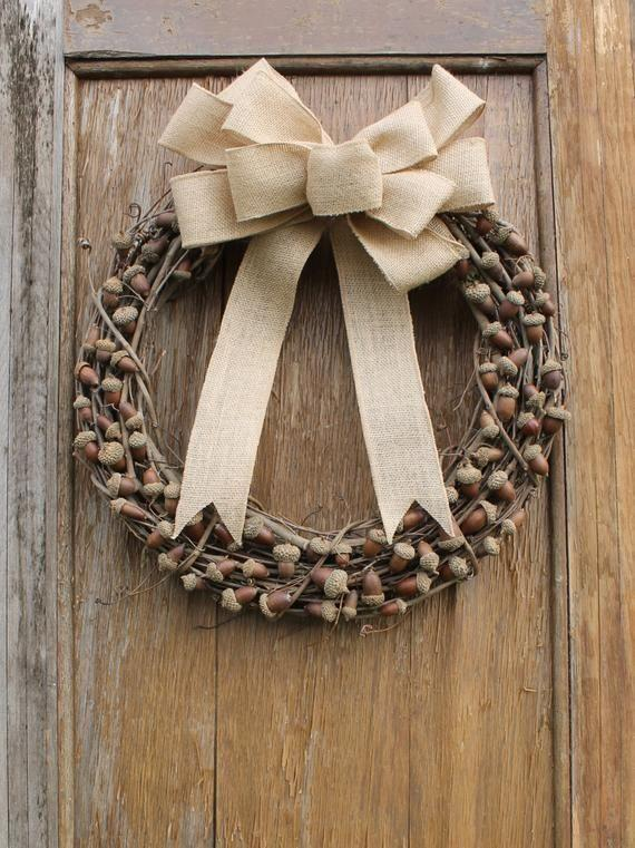 """<p><strong>HeartOfHomeDesign</strong></p><p>etsy.com</p><p><strong>$68.00</strong></p><p><a href=""""https://go.redirectingat.com?id=74968X1596630&url=https%3A%2F%2Fwww.etsy.com%2Flisting%2F254181059%2Facorn-wreath-fall-wreath-autumn-wreath&sref=https%3A%2F%2Fwww.housebeautiful.com%2Fhome-remodeling%2Fdiy-projects%2Fg2586%2Ffall-wreaths%2F"""" rel=""""nofollow noopener"""" target=""""_blank"""" data-ylk=""""slk:BUY NOW"""" class=""""link rapid-noclick-resp"""">BUY NOW</a></p><p>This wreath is definitely nutty, but only in the best way. Choose from 40 different kinds of ribbon to match your own front door.</p>"""