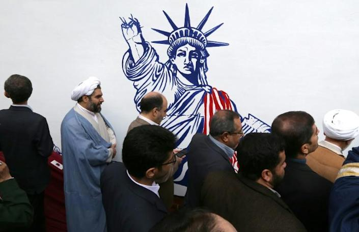 """The political artworks were unveiled by the head of Iran's Revolutionary Guards, Major General Hossein Salami, at a televised ceremony at the former US embassy that Iran calls the """"den of spies"""" (AFP Photo/ATTA KENARE)"""