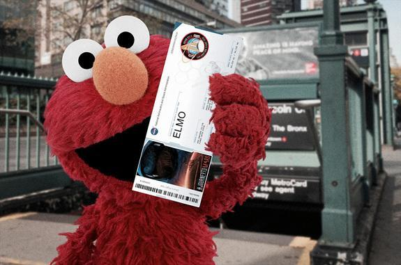 Sesame Street's Elmo shows off his NASA-issued boarding pass for the Orion test flight, launching on Dec. 4.
