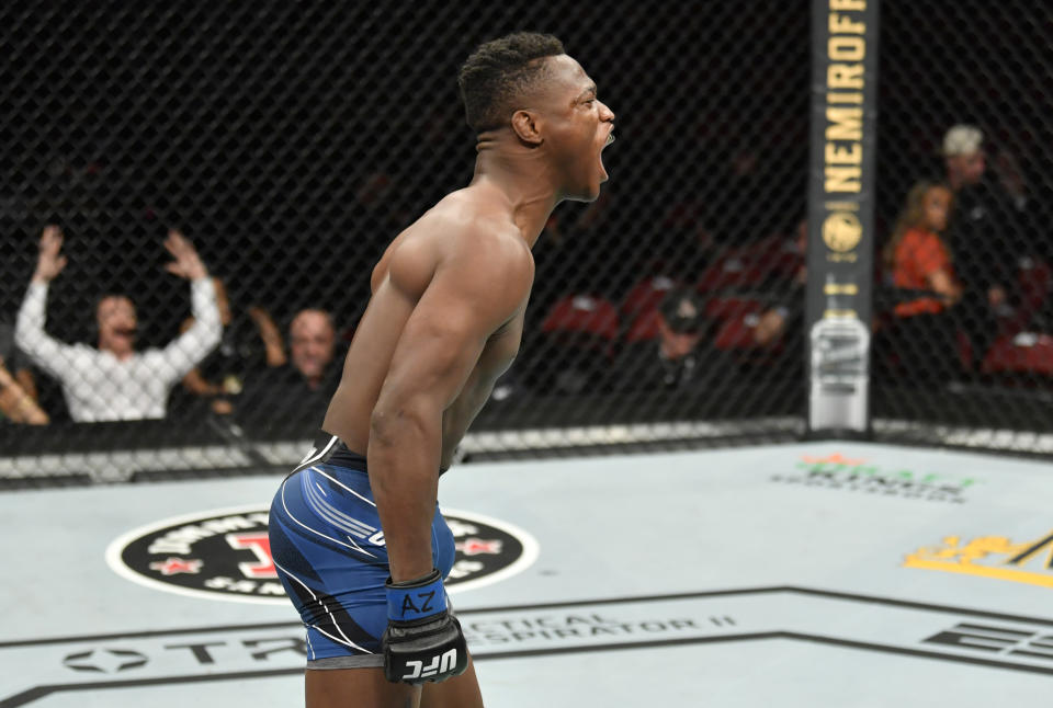 Terrance McKinney celebrates after knocking out Matt Frevola in their lightweight fight during the UFC 263 event at Gila River Arena on June 12, 2021 in Glendale, Arizona. (Photo by Jeff Bottari/Zuffa LLC)