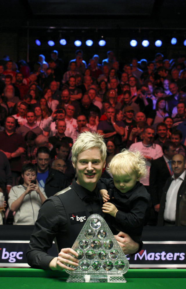Australia's Neil Roberts poses with his son Alexander and the trophy of the Masters after winning over England's Shaun Murphy in the BGC Masters snooker final at Alexandra Palace in London on January 22, 2012. Australia's 2010 world champion Neil Robertson claimed the Masters title with a 10-6 win over England's Shaun Murphy at Alexandra Palace. AFP PHOTO / JUSTIN TALLIS (Photo credit should read JUSTIN TALLIS/AFP/Getty Images)