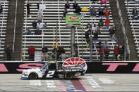NASCAR Texas Trucks Series driver Sheldon Creed (2) crosses the finish line to win an auto race at Texas Motor Speedway in Fort Worth, Texas, Sunday, Oct. 25, 2020. (AP Photo/Richard W. Rodriguez)