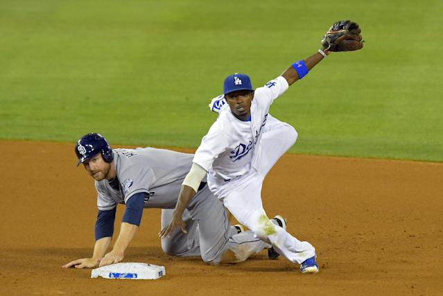 San Diego Padres' Chase Headley, left, is forced out at second as Los Angeles Dodgers second baseman Dee Gordon throws out Carlos Quentin at first during the seventh inning of a baseball game on Saturday, July 12, 2014, in Los Angeles. (AP Photo/Mark J. Terrill)