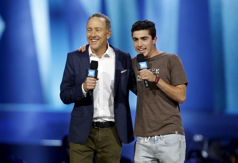 Chief Executive Officer and President of Pacific Sunwear of California Inc. Gary H. Schoenfeld and his son speak on stage during WE Day California in Inglewood