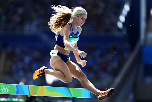 <p>Emma Coburn of the United States competes in the Women's 3000m Steeplechase Round 1 on Day 8 of the Rio 2016 Olympic Games at the Olympic Stadium on August 13, 2016 in Rio de Janeiro, Brazil. (Photo by Paul Gilham/Getty Images) </p>