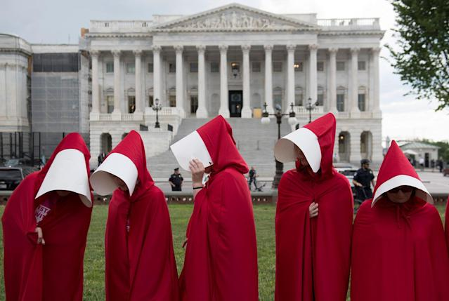 "<p>Supporters of Planned Parenthood dressed as characters from ""The Handmaid's Tale,"" hold a rally as they protest the U.S. Senate Republicans' healthcare bill outside the US Capitol in Washington, June 27, 2017. (Photo: Saul Loeb/AFP/Getty Images) </p>"