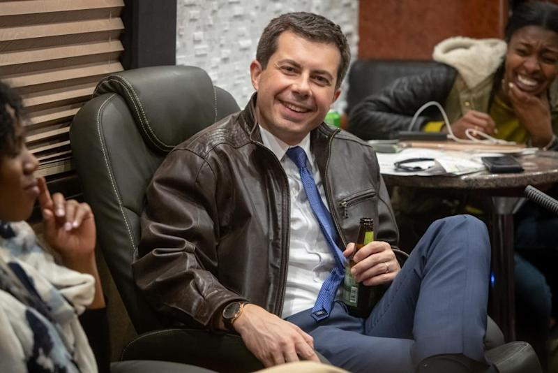 Pete Buttigieg has a beer on the bus with reporters after a campaign event in Decorah, Iowa, on 2 November. 'I think it's important that I have private sector experience,' he said.