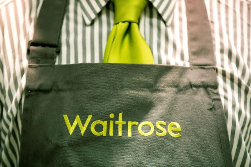 FILE PHOTO: A Waitrose staff member's uniform is seen in London