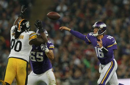 Minnesota Vikings quarterback Cassel throws in the fourth quarter as Pittsburgh Steelers nose tackle McLendon defends during their NFL football game at Wembley Stadium in London