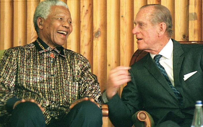 Former South African president Nelson Mandela and Prince Philip at Drakenstein Prison, Paarl about 50 kms outside of Cape Town, in 2000 - ANNA ZIEMINSKI/AFP/Getty Images