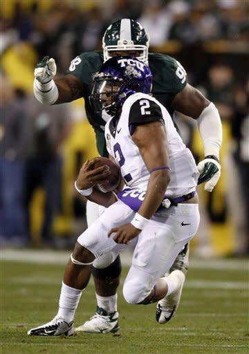 TCU quarterback Trevone Boykin (2) carries the ball during the first quarter of the Buffalo Wild Wings Bowl NCAA college football game against Michigan State, Saturday, Dec. 29, 2012, in Tempe, Ariz. (AP Photo/The Arizona Republic, Cheryl Evans)