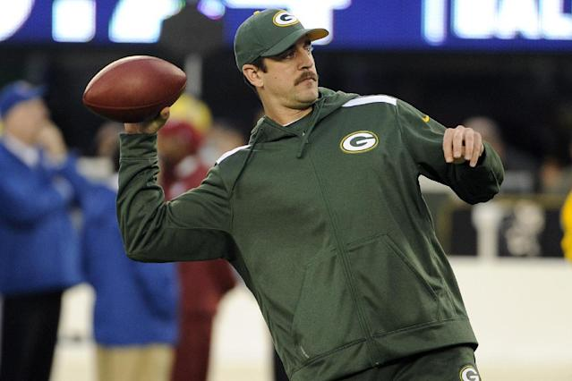 Green Bay Packers quarterback Aaron Rodgers throws a pass as his team warms up before an NFL football game against the New York Giants, Sunday, Nov. 17, 2013, in East Rutherford, N.J. (AP Photo/Bill Kostroun)